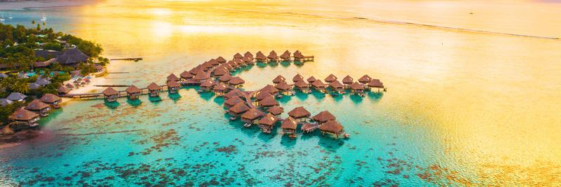 Luxury travel vacation destination panoramic banner. Romantic honeymoon getaway in overwater bungalows villas of Tahiti resort, Bora Bora, French Polynesia. Landscape copy space panorama