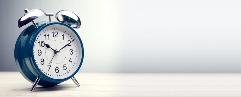 green alarm clock morning time