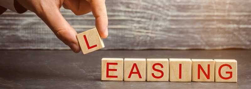 Man puts cubes with the word Leasing. A lease is a contractual arrangement calling for the lessee to pay the lessor for use of an asset. Property, buildings, vehicles are common assets that are leased