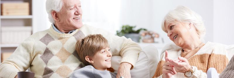 Boy having tea with grandparents