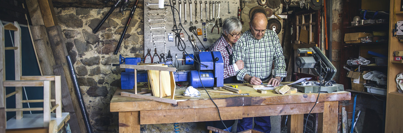 Senior couple working in a carpentry workshop