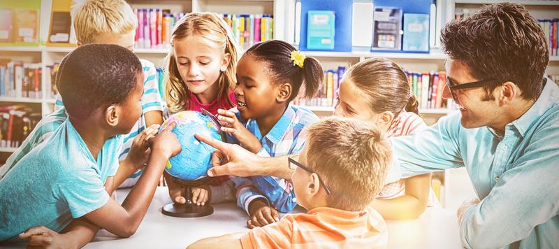 Teacher and kids discussing globe