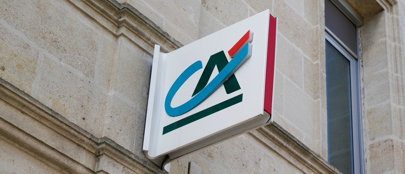 Credit Agricole sign logo on bank agency facade store office