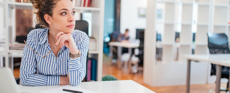Portrait of a pensive female office worker.