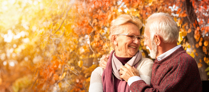 Tender senior couple embracing on bench