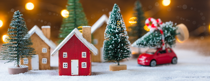 Roof of the Miniature Christmas wooden house on the snow with lights, toned, banner