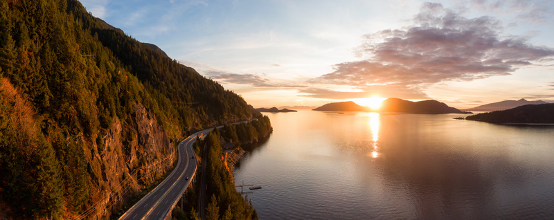 Sea to Sky Hwy in Howe Sound near Horseshoe Bay, West Vancouver, British Columbia, Canada. Aerial panoramic view during a colorful sunset in Fall Season.