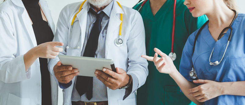 Group of doctor with tablet on white background