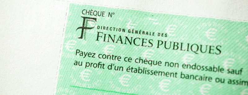PARIS, FRANCE - JAN 1, 2015: Detail of French Cheque issued by the Direction Generale des Finances Publiques - the division of Economic Minister responsible for income taxes