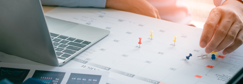 Business Man with laptop, Calendar in office, Business management event . Organizational management, business plan targeted marketing activities, media relations advertising