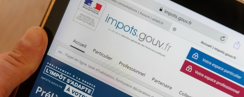 Paris, France - November 15, 2018 : French tax website on a digital tablet. Reform of the payment of tax at source