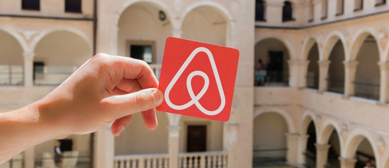 Minsk, Belarus - November, 2017: Travel around the world with Airbnb. Logo of famouse booking company Airbnb.