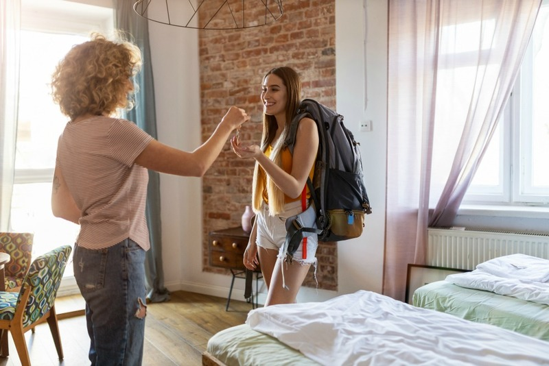 Young female backpacker renting apartment
