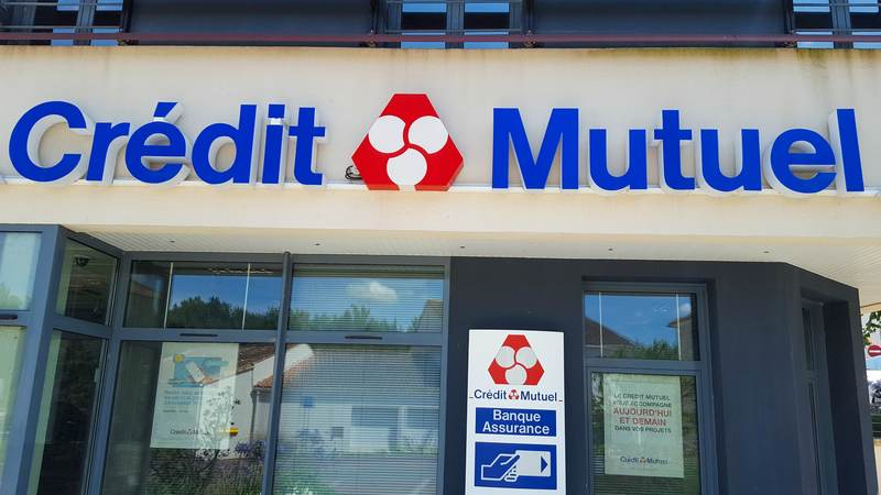 credit mutuel text sign on bank with logo office on building facade