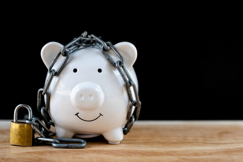 White Piggy bank locked, chained with black background, Protect savings, Protect capital, Protect retirement fund concept